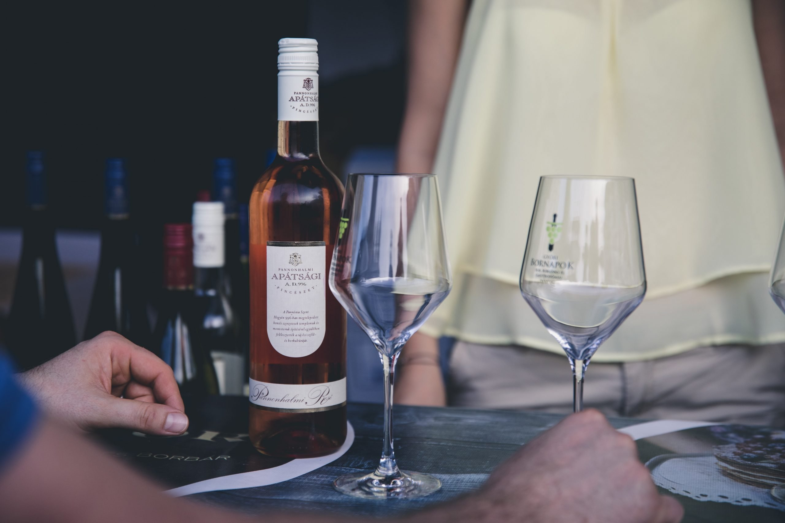 A photo of Apatsagi wine and two wine glasses