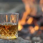 A photo of a glass of whiskey