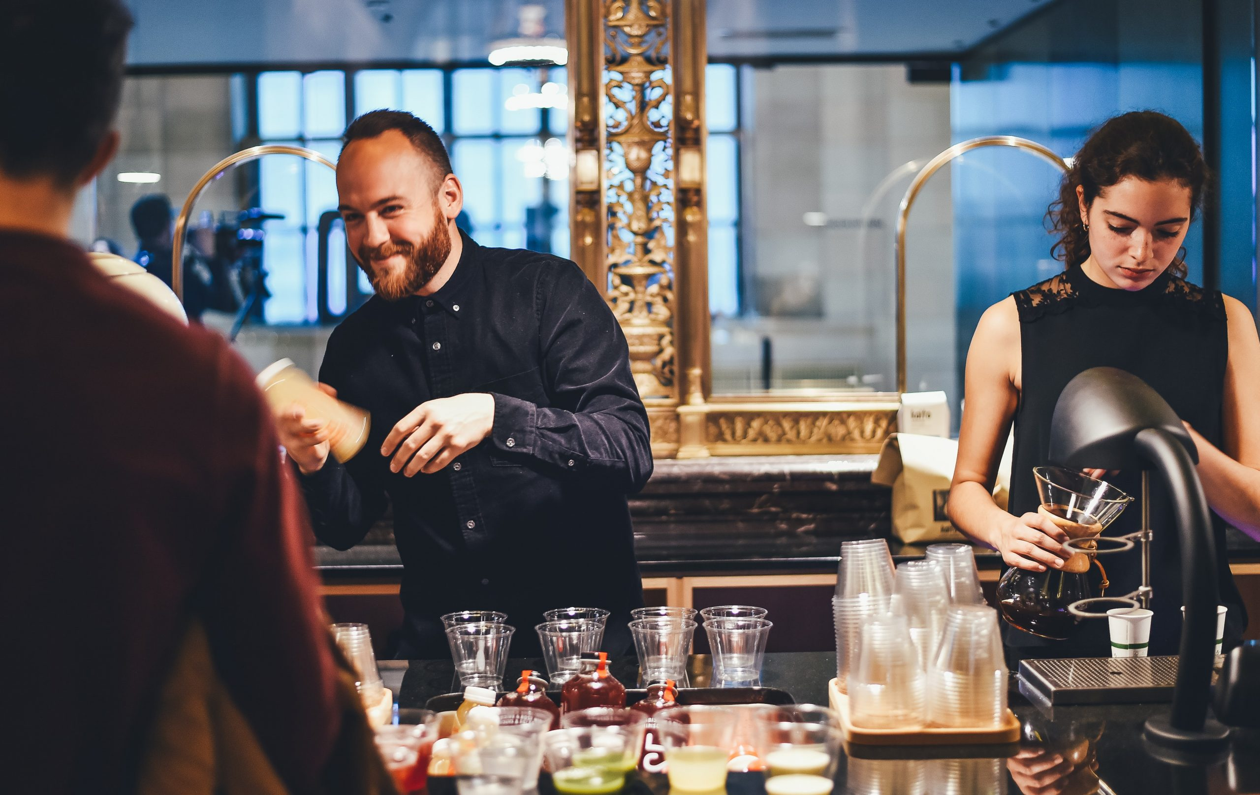 A photo of two bartenders