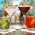 A photo of four cocktails