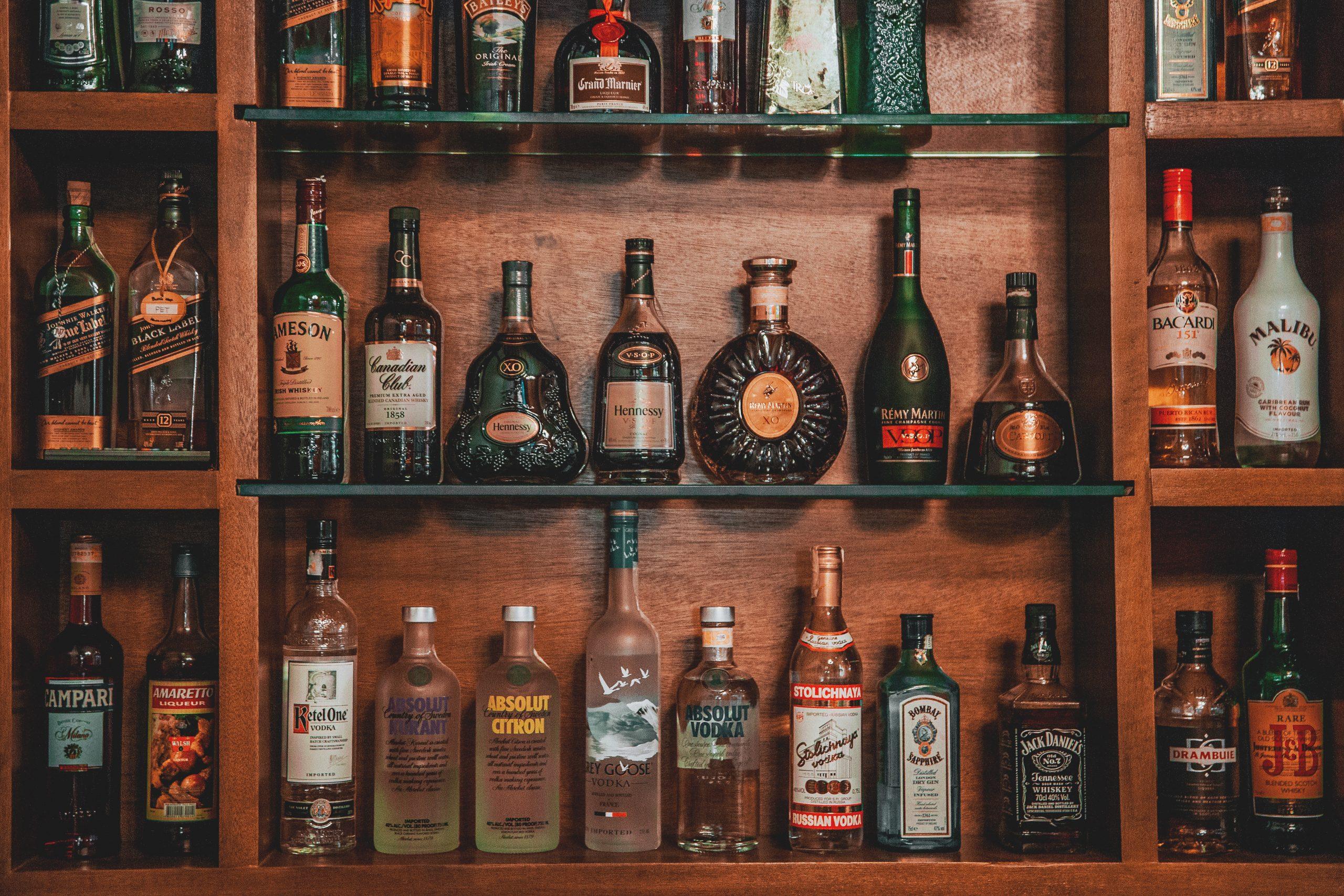 A photo of liquor on shelves.