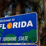 A photo with a sign that says Welcome to Florida