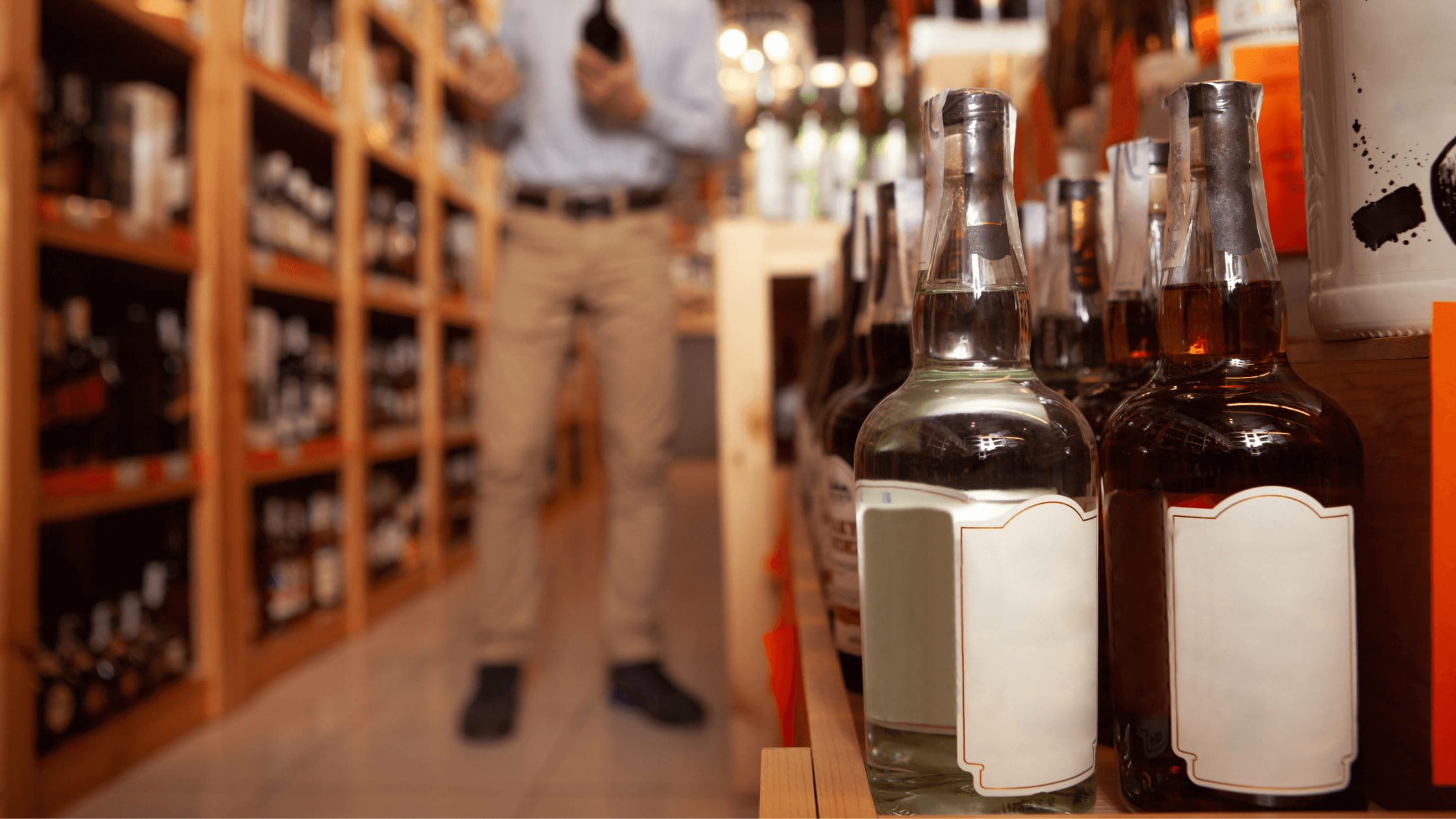 A photo with shelves that include liquor bottles.