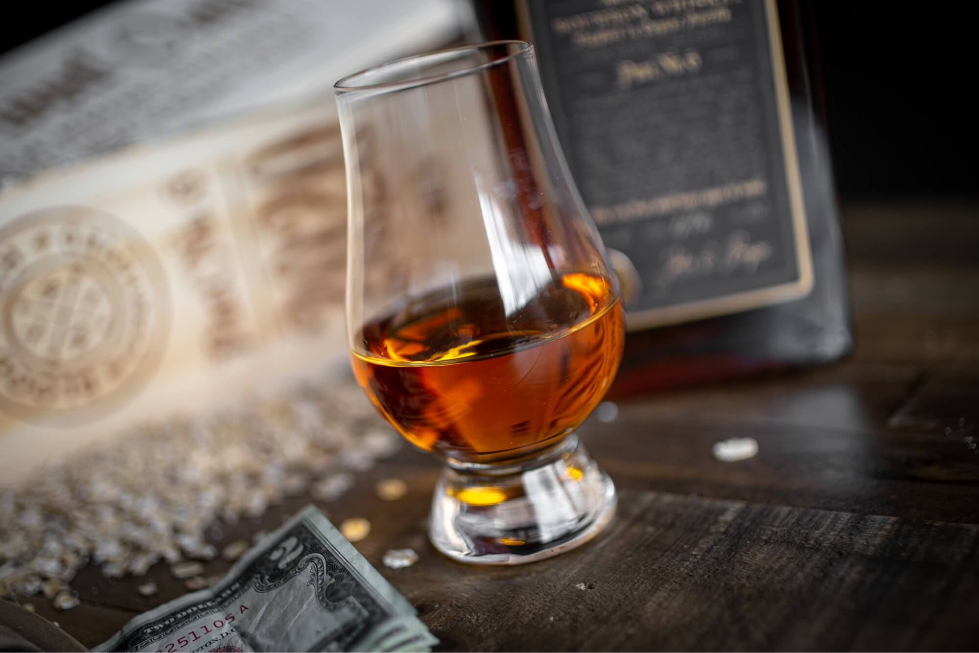 A photo of a shot of whiskey.